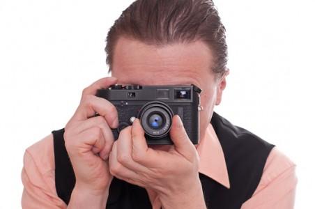 Selbstportrait Fotograf mit Leica M7 von vorne