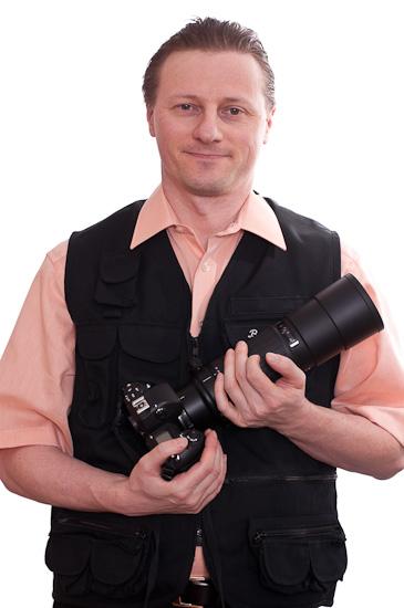Selbstportrait als Fotograf mit Teleobjektiv